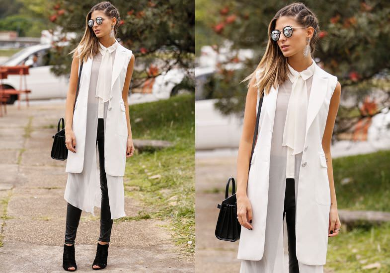 Look preto e branco com maxi colete, combinado com camisa de laço.